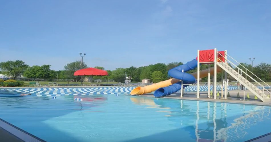 Outdoor pool with slide  Outdoor Pool with Double Flume Slide   Baxter Y   YMCA of Greater ...