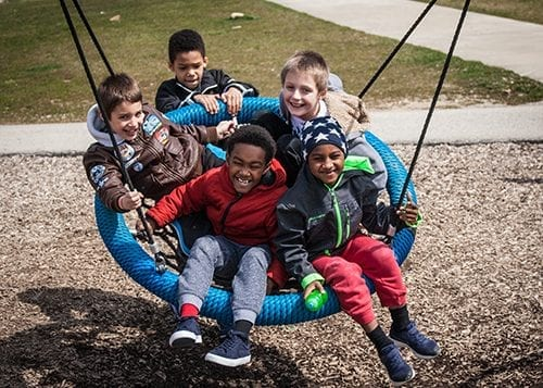 Kids on a swing | Before & After School | Youth Development